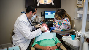 Fairfax Preventive Dentistry woman receiving dental exam